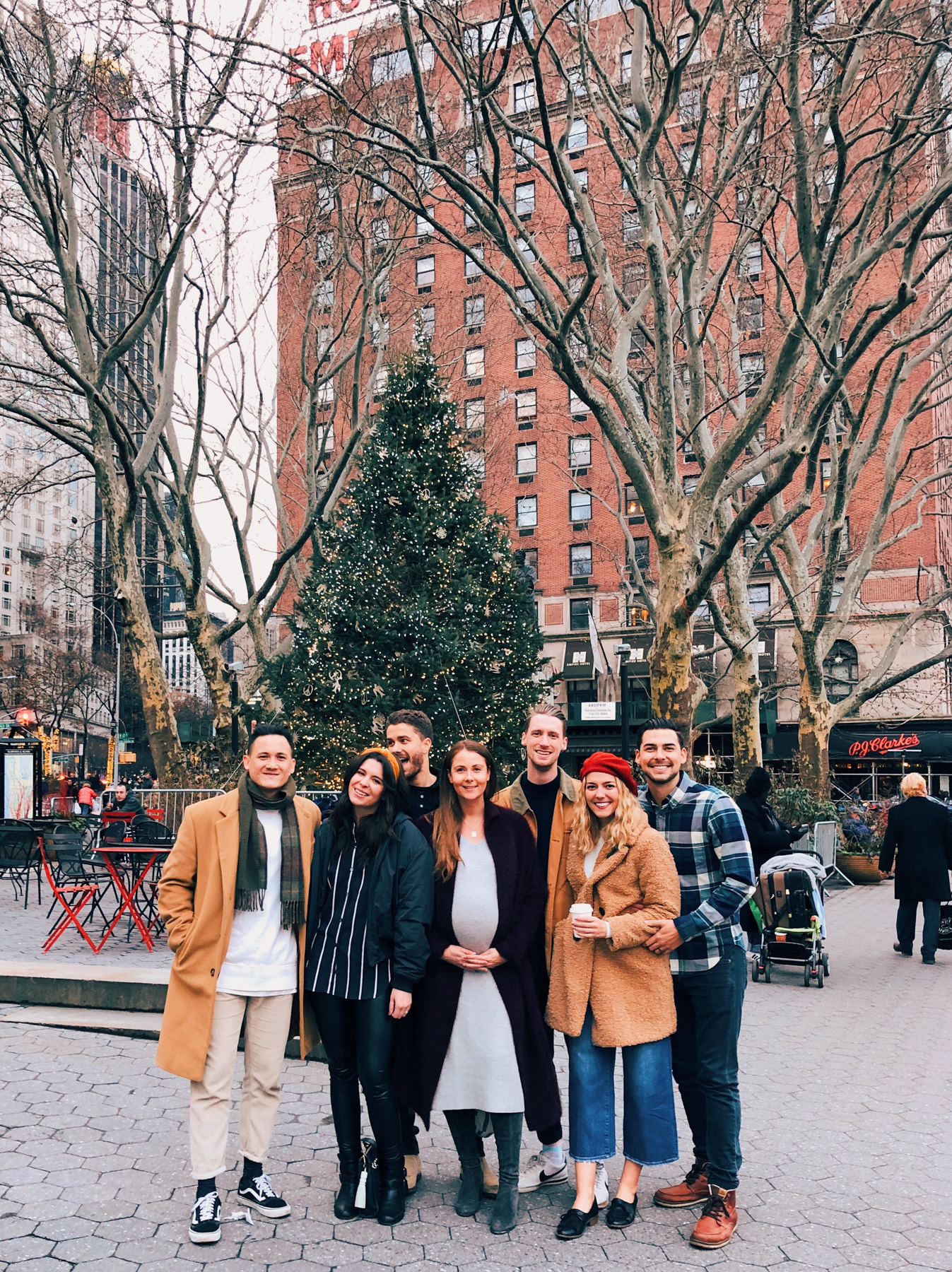 The New York fam in front of the Christmas Tree in Lincoln Square