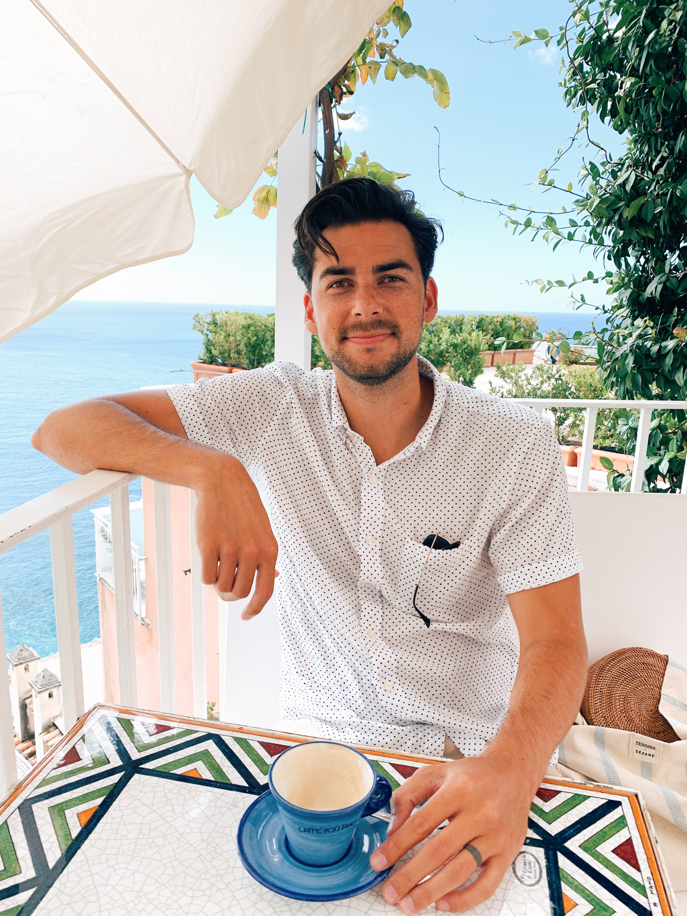 Nate enjoying his coffee with a view at Cafe Positano