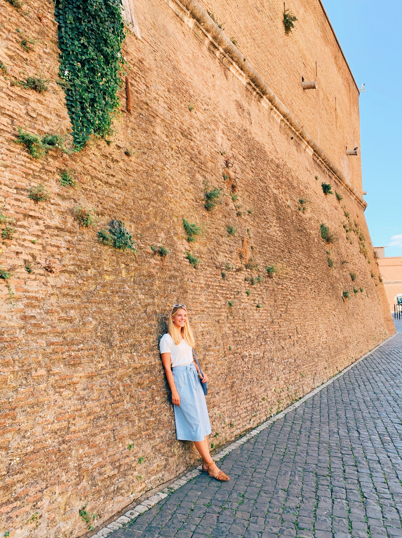 Me leaning on the walls of Vatican City.