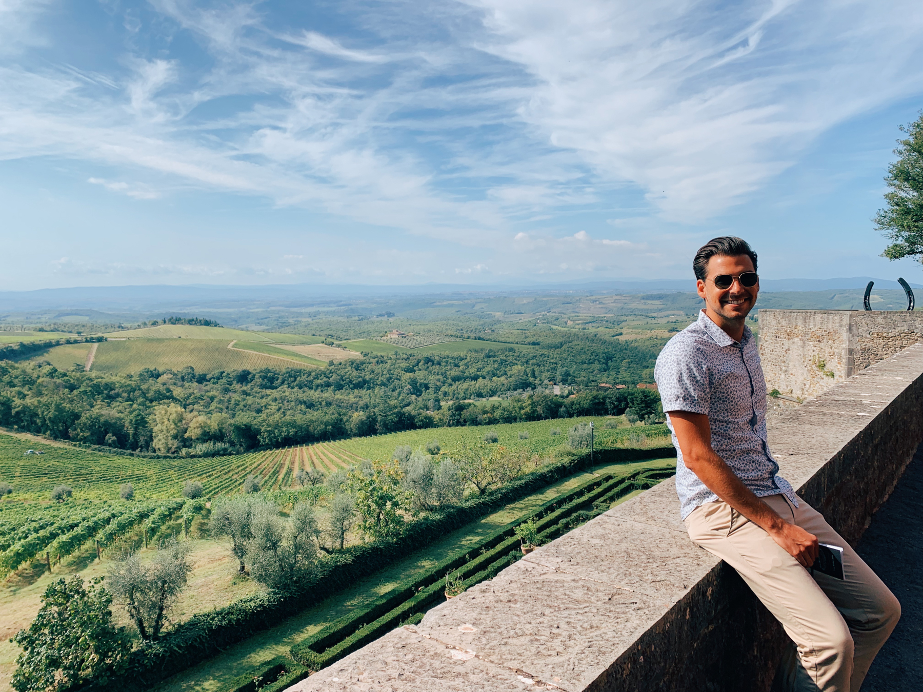 Nate with the view of Tuscany behind him.